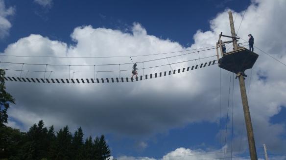 Zipline high in sky on bridge