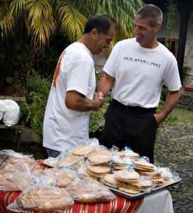 Operation Walk - Jose the baker at food table with Dr.