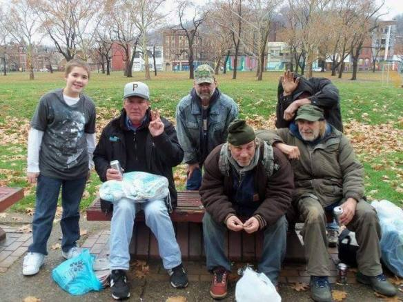 Keep Yinz Warm - Young Jon with group of homeless men - good