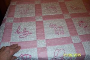 Joyce - mom's hand on quilt