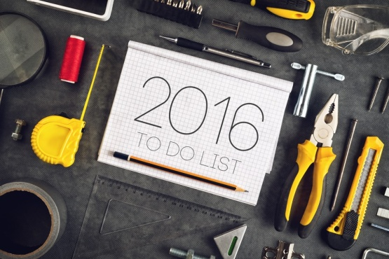 2016, New Year Resolutions Craftsman Workshop Concept with Asorted Tools, Pencil and Notebook for Writing Goals and Aspiration in Following Year
